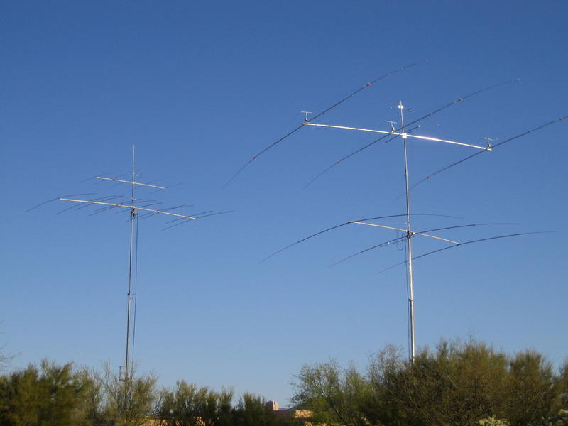 Left tower is a Tri-ex sky needle at 72 feet. The bottom antenna is a 51 foot long boom with 5 elements on 20 meters interlaced with 5 elements on 15 meters. The top antenna is 5 elements on 10 meters long boom. The right side tower is a Tri-ex 100 foot sky needle with 3 full size elements on 40 meters at 70n feet and a 3 element 75/80 meter yagi at 100 feet. Element lenghts are 100 feet and uses high