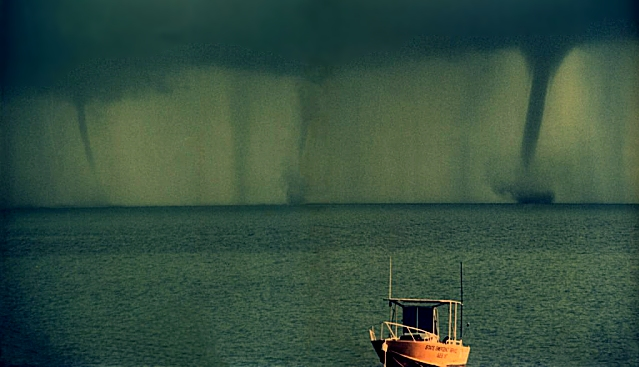 Waterspouts off Sweers Island