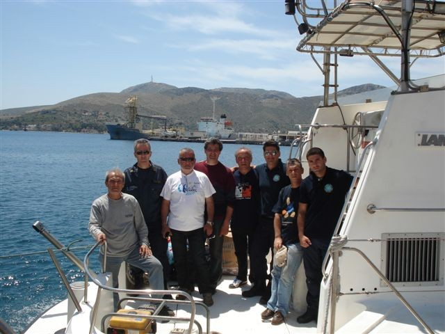SX5F team on the boat with a part of the ship staff.jpg