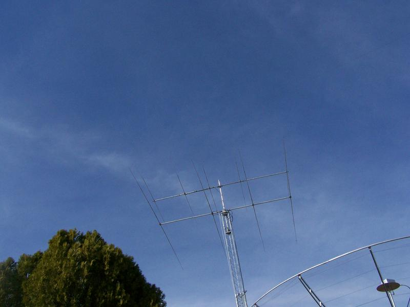 15 METER YAGI ON TOP WITH 20 METER YAGI ON BOTTOM 10.7 METER DISH IN FORGROUND