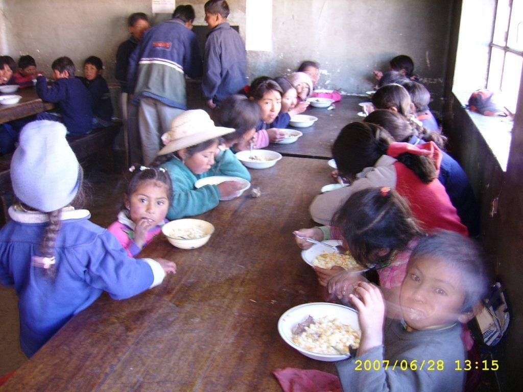 Children get their meal from the parish