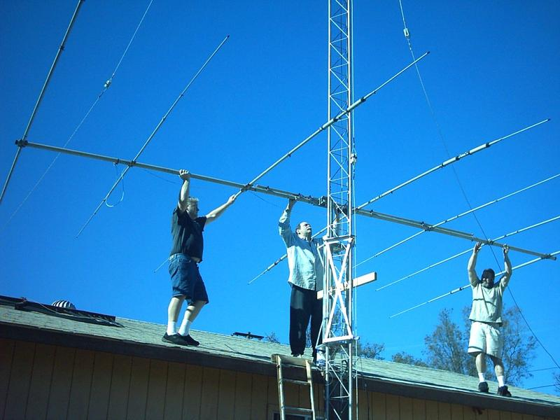 Kevin Gaudette and Jergen Lazer assist in the placement of the re-built TH7DX antenna at KB6PJU